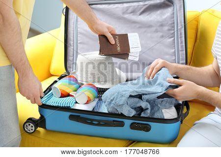 Happy gay couple preparing for trip