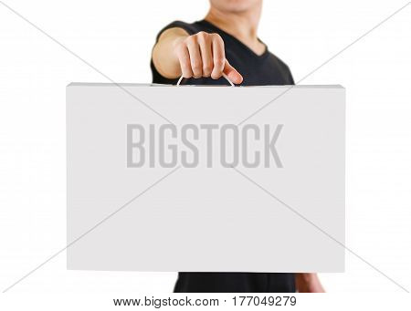 Man In A Black Shirt Holds A White Box With A Handle. Packing Box For Laptop. Isolated On White Back