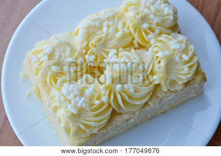 vanilla chiffon cake decorate cream on dish