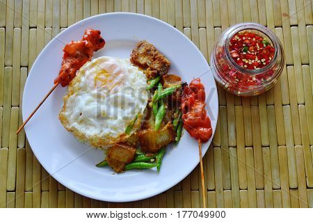 spicy stir fried crispy pork curry with egg and chili fish sauce