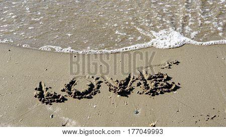LOVE on the beach, write LOVE on the sand.