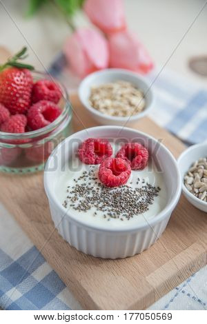 healty Yogurt with baked granola and berries on a table