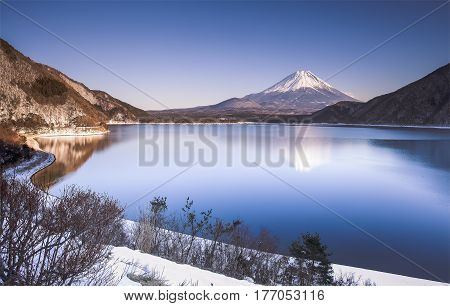 Mountain Fuji and Motosu lake with snow fall in winter season