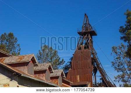 Historic Mining Operations Building With Rusty Iron Tower