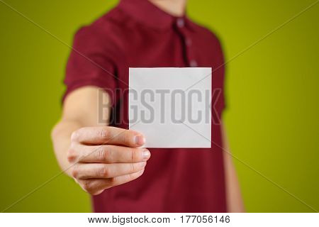 Man Showing Blank White Square Flyer Brochure Booklet. Leaflet Presentation. Pamphlet Hold Hands. Ma