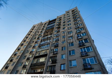residential house on blue sky background. Block of flats from soviet times.