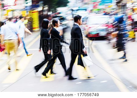 Crowd Of People Crossing A Street In Hongkong