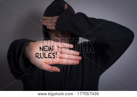 New Rules. Women showing hand with text.
