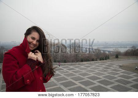 portrait of smiling girl vith city panarama on background