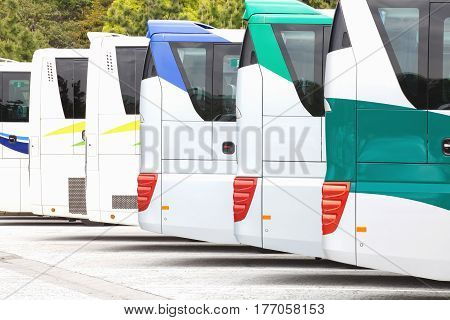 Row of Tourist bus coach parked at carpark