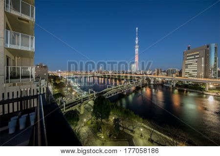 Tokyo Sumida river view with Tokyo Skytree in evening. The Sumida river is a river that flows through Tokyo Japan.