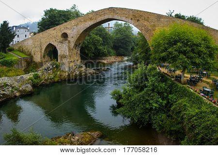 Image of Old Roman stone bridge in Cangas de Onis in Asturias Spain