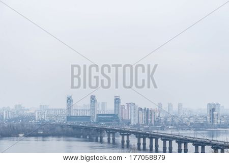 panarama view on city in fog with bridge cross the river