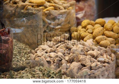 Exotic Spices kept for sale in huge bags in an Arabian market