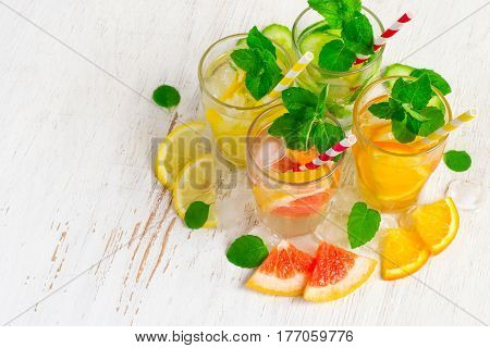 Set of Cucumber grapefruit lemon orange mint  infused water for detox on a white background. Concept of summer drinks