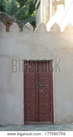 A traditional Arabian door with beautiful design on an old Arabic house