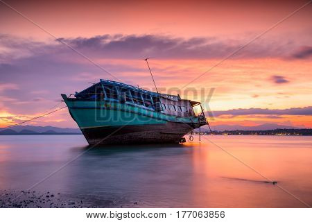 Fishing boat on tropical beach in beautiful sunset background Thailand.