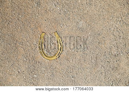 Horseshoe in the ground. Old horseshoe, background.copy space for your text