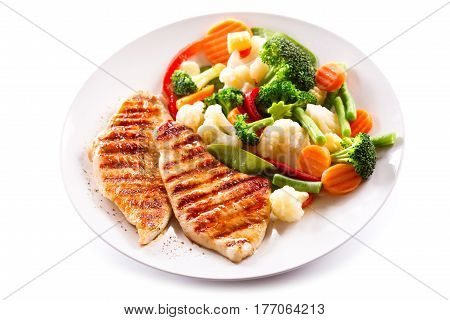 Plate Of Grilled Chicken With Vegetables On White Background