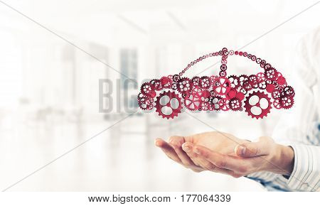 Man presenting in palms concept of car transporation or insurance