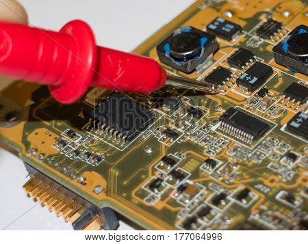Checking the components of the laptop motherboard with a multimeter