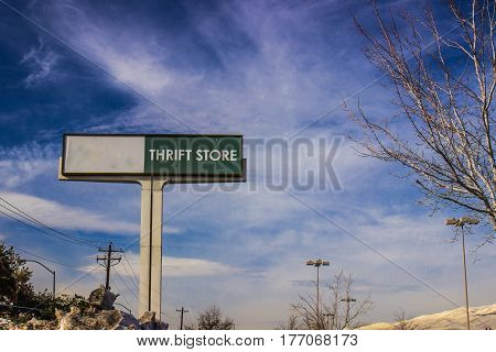 Thrift Store Location Sign With Blue Sky Background