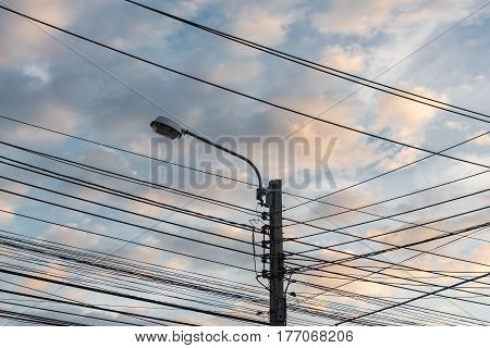 Electricity Post And Street Light With Blue Sky
