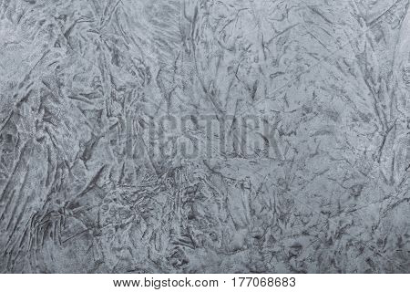 Grey painted canvas with creases, abstract paint background with copyspace