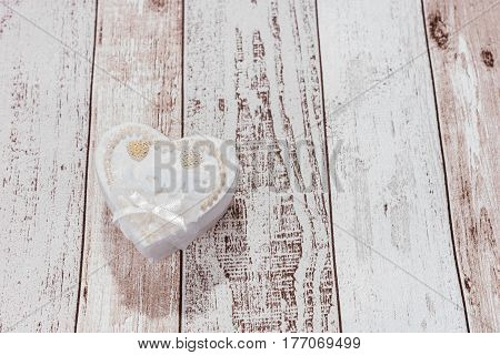 One heart with the word Love on wooden background