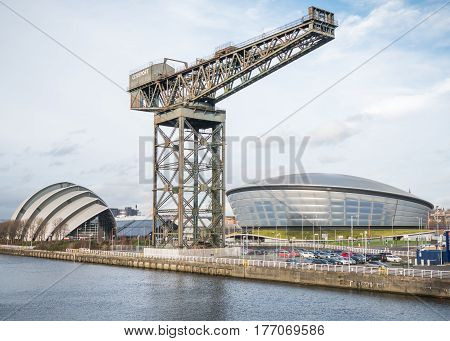 GLASGOW, SCOTLAND - 31 JAN 2017: The Clyde Auditorium, Hydro Arena and Finnieston crane on the banks of the river Clyde as seen from the Clyde Arc Bridge. These buildings are an important part of modern Glasgow