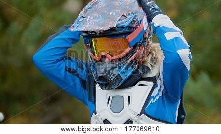 MX moto Girl in a helmet - cross racing, telephoto