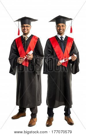Two african american graduates in gown and cap isolated over white background