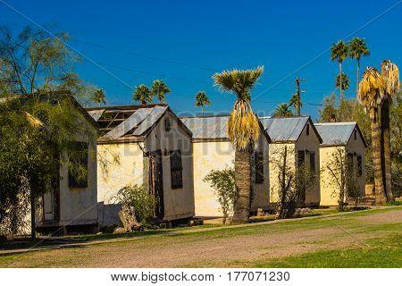 Abandoned Individual Motel Units In Disrepair In Arizona Desert
