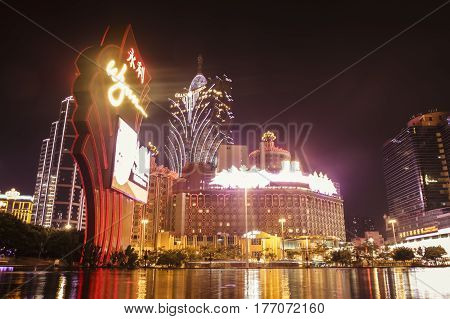 Macau China - 1 October 2010: Casinos with bright neon lights lit up in central Macau at nighttime