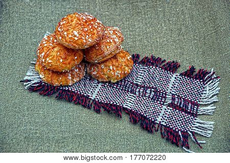 Fresh baked donuts on a woolen shawl