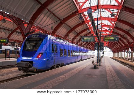 MALMO SWEDEN - MARCH 07 2017: Train in Malmo Central station railway station opened in 1856 which serves approximately 17 million passengers per year making it the third busiest in Sweden behind Stockholm and Gothenburg.