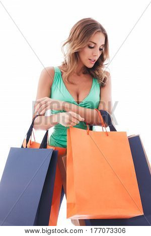 Young happy smiling woman with shopping bags isolated on white background