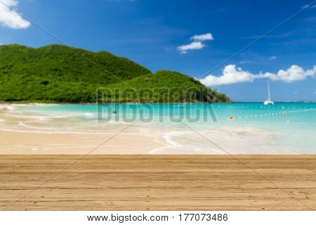 Wooden decking or picnic table on Anse Marcel beach on St Martin in Caribbean in idyllic dreamlike location