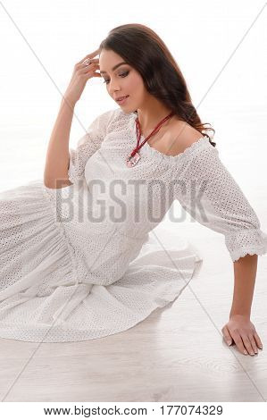 Young sensual long hair model wearing luxury silver accessory and jewelry. Girl Isolated on white background