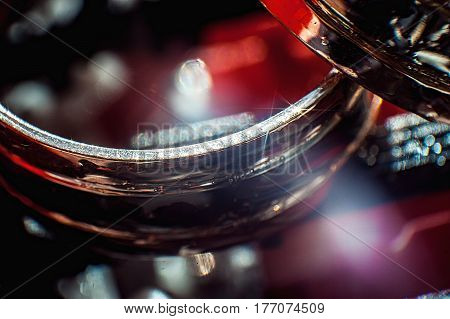 wet wedding rings. sun shine. red background