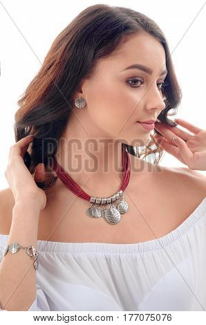 Elegant beautiful girl model with long brown hair fresh skin wearing accessories and jewelry isolated over white background