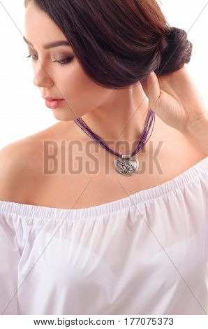 Close up portrait of beautiful woman model with long brown hair fresh skin wearing accessories and jewelry isolated over white background