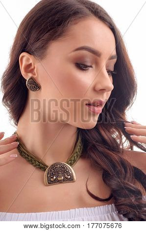 Portrait of young pretty woman with bijouterie on white background