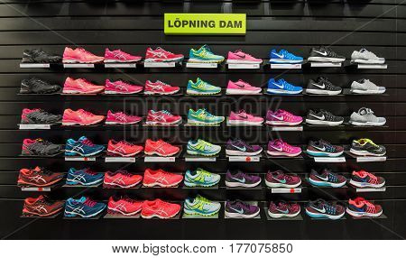 MALMO SWEDEN - MARCH 08 2017: Various models and brands of running shoes for ladies in Stadium store in Malmo's Emporia Shopping Center.