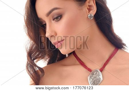 Beauty Woman With Long Brown Hair fresh skin wearing accessories and jewelry isolated over white background