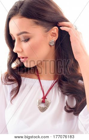 Portrait of gorgeous woman model with long brown hair fresh skin wearing accessories and jewelry isolated over white background