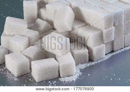 white granulated sugar on a gray background