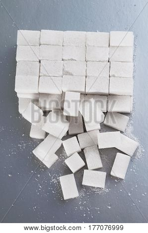 Top view on cubes sugar. background of sugar cubes