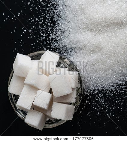 Several types of white sugar refined sugar and granulated sugar. Top view