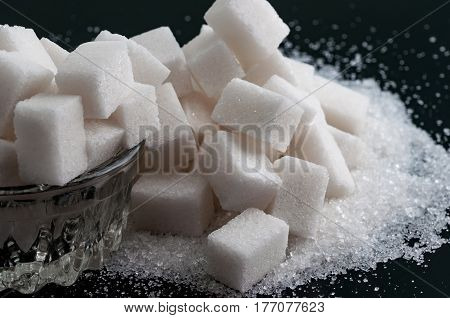 Two kind of sugar on black surface